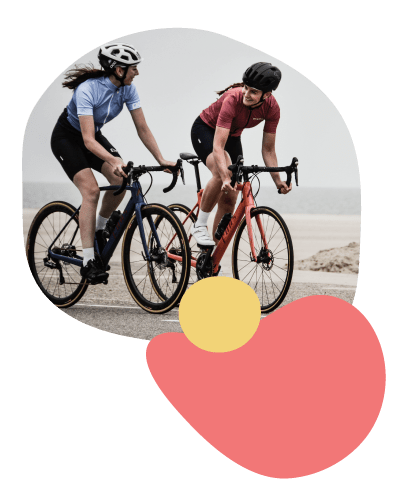 Two women cycling bikes